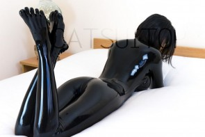 New female's latex catsuit with toe socks glued with front zip to ass